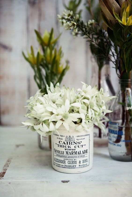 Antique stoneware jar filled with  Australian flannel flowers #rustic #vintage #tablecentre #white