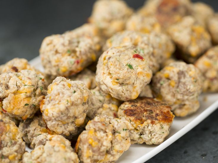 Spicy Pimiento Cheese Sausage Balls  | If you thought you had your perfect, go-to sausage ball recipe—wait until you've tried these. Using prepared pimiento cheese in this party food favorite eliminates the need to shred cheese when it comes time to prep your sausage balls, and keeps them from drying out in the oven—as sausage balls are prone to do. In other words, this ultimate appetizer recipe is as genius as it is delicious.