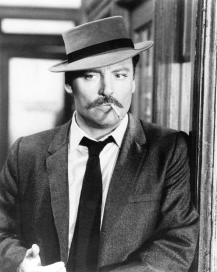 Stacey Keach portraying fictional detective Mike Hammer in a 1984 TV series, Mickey Spillane's Mike Hammer, for one season (due to a cocaine arrest in England) and then a recurring series of television films starting in 1986.