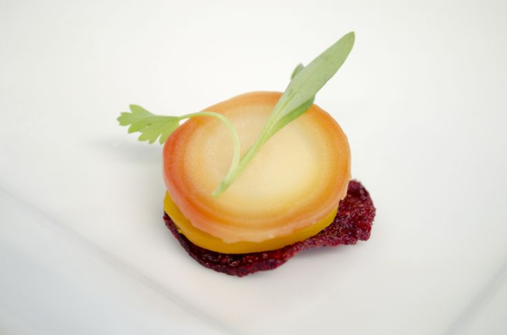 Baby Beet Napoleon with lemon-chive goat cheese mousse on a beet chip