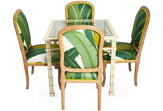 Fern leaf green and white upholstered dining chairs.