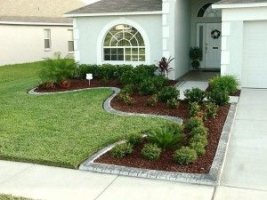 like the landscaping around the driveway for a small front yard - Front Garden Idea