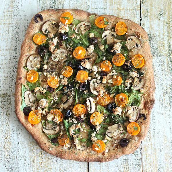 Halloween Recipes : Almond Feta, Mushroom, greens, olives, golden cherry tomatoes Pizza with Thin Herbed Spelt Crust. vegan recipe