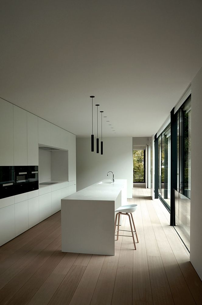 Minimalist kitchen with wood floors.