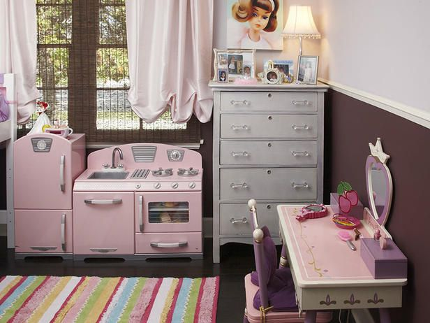 Vanessa DeLeon created a studio apartment feel by adding a play kitchenette and dressing table to this little girl's room.