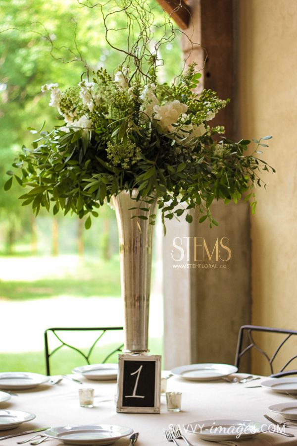 Some of the centerpieces will be tall silver vases filled with seasonal greenery and white stock flowers, surrounded by gold mercury glass votives.  www.stemfloral.com  I  www.savvy-images.com