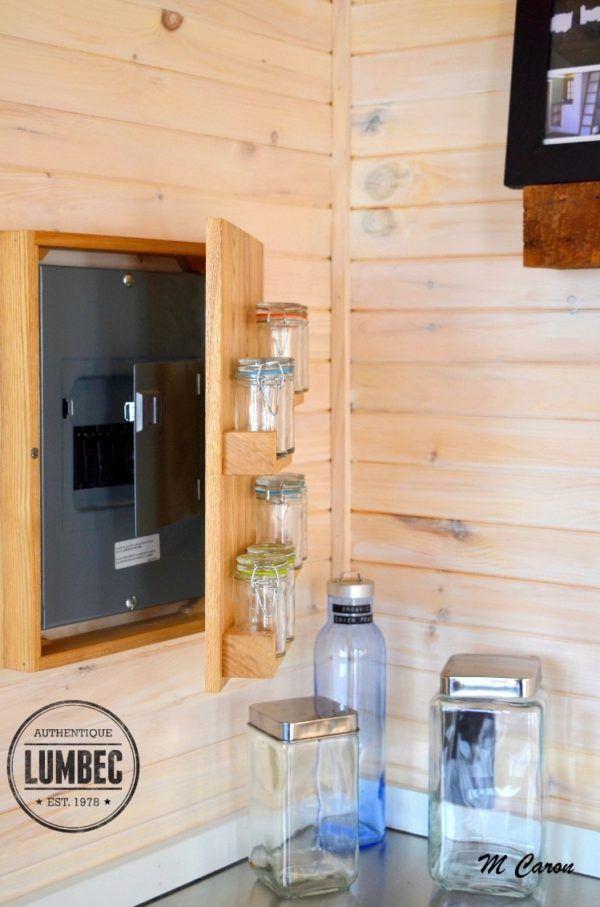 micro lumbec tiny house on wheels 007 great idea to hide fuse panel inside - Tiny House Storage Ideas
