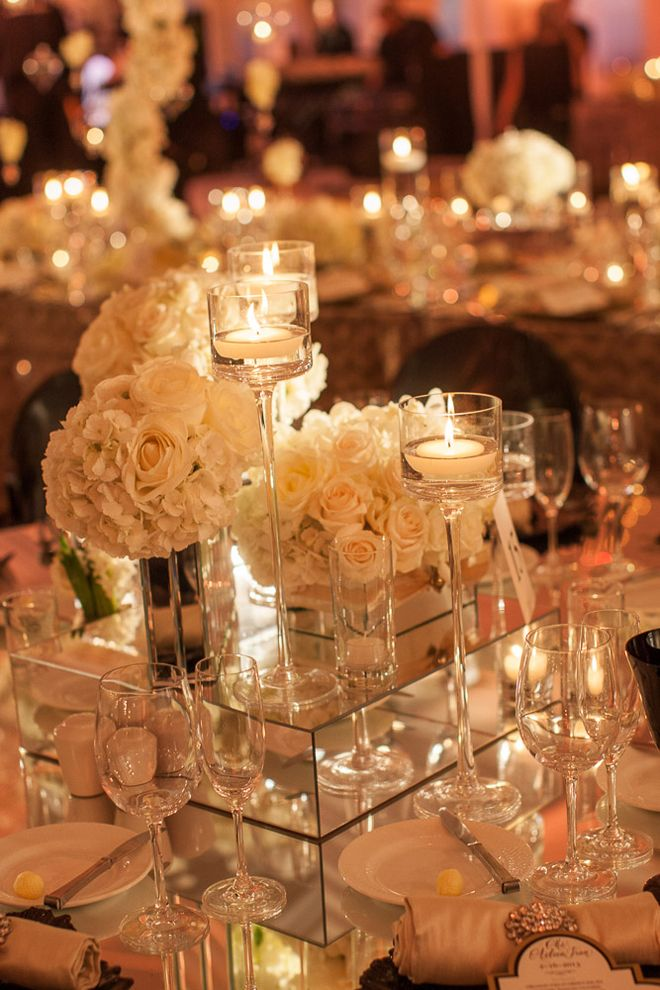 White Roses And High Candles Wedding Centerpiece   I Love How Its Raised  Motzouris Look At The Mirror Raised Block