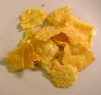 Cheese chips. just grated cheese (parmesan or pecorino or something similar) on hot pan.