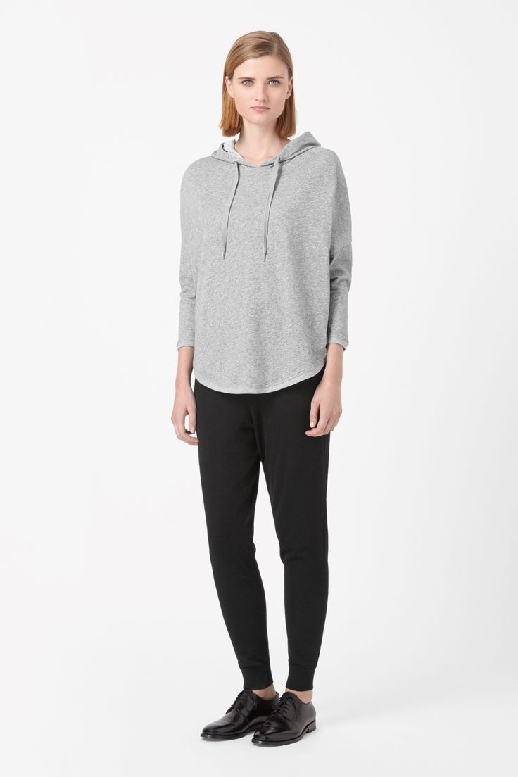 A comfortable oversized fit, this hooded top is made from soft cotton jersey with a melange finish. Rounded at the edges, it has 3/4 sleeves, a curved hemline and dropped shoulder seams.