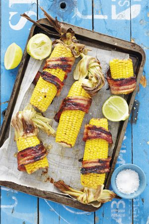 A juicy mealie makes for a versatile summer dish: blanch four mealies in boiling water, wrap a strip of rindless bacon around each one and place on a baking tray. Drizzle with butter flavoured with chilli, herbs and honey, then bake them in a warm oven until the bacon is crispy. Serve immediately. - See more at: http://homemag.co.za/news/family-food-9/#sthash.qCkrjtBe.dpuf