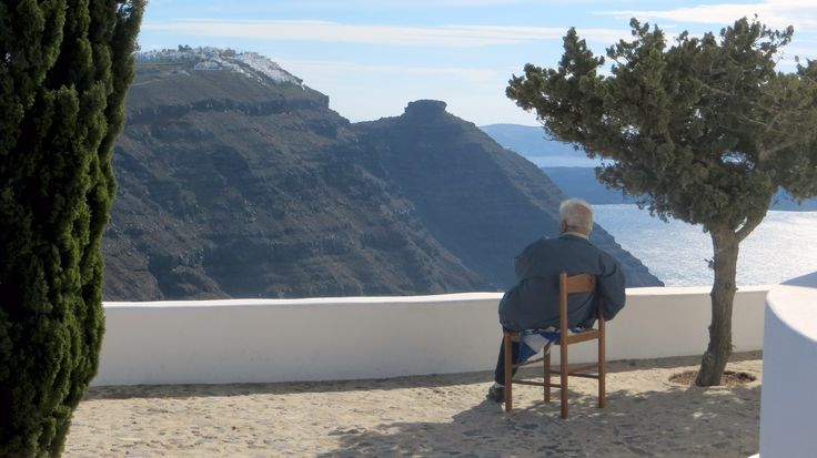 Local man overlooking coastline