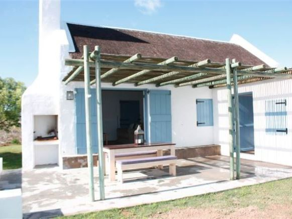 Harmonie 2 - Harmonie 2 is a beautiful thatch home with stunning sea views over the greenbelt and towards the beach. This self-catering house is ideal for small families of up to four people looking for a quiet seaside ... #weekendgetaways #paternoster #southafrica