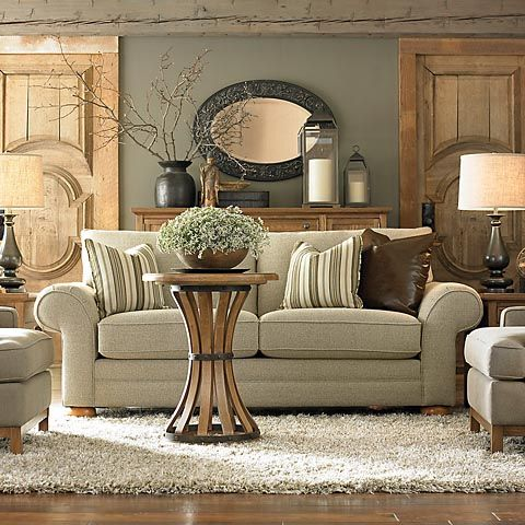 Comfy, inviting room! Soft colors and rustic accessories. Love the matching panels at the back wall...they bring height and texture into the room.