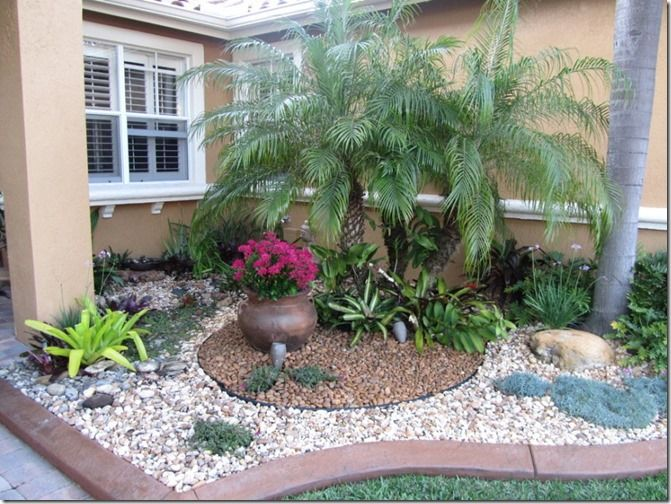 dwarf-trees-for-landscaping-in-landscaping-ideas-for-front-yard-plus-decorative-gravel-and-palm-tree-for-tropical-landscapes-in-traditional-home-with-rail-chair-on-exterior-wall-915x685                                                                                                                                                                                 More