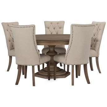 Includes:Round dining table and four upholstered chairs  Put classic design on a pedestal with the Haddie round dining set. With an impressive turned base that celebrates timeless beauty, this dining set is paired with nailhead-trimmed chairs with button diamond tufting.