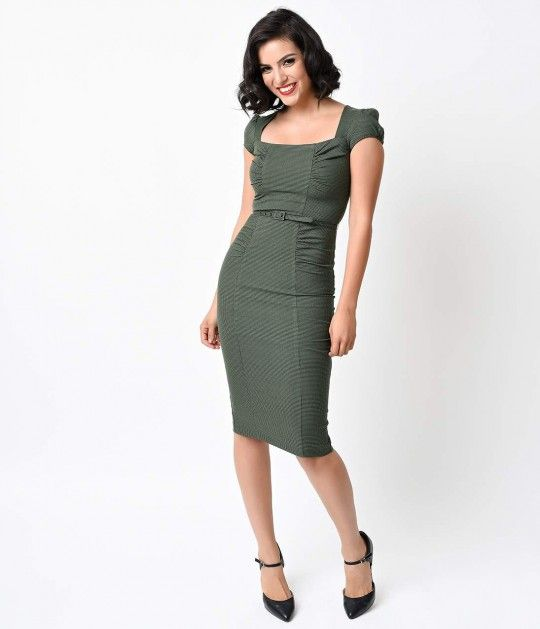 Prepare for stares! Modeled after the coveted vintage dresses of the 40s, The Verdant Dress is freshly picked from Stop Staring in gorgeous seasonal splendor. Crafted in a lightweight yet strong woven tri-blend in a deep olive houndstooth check. With a sq