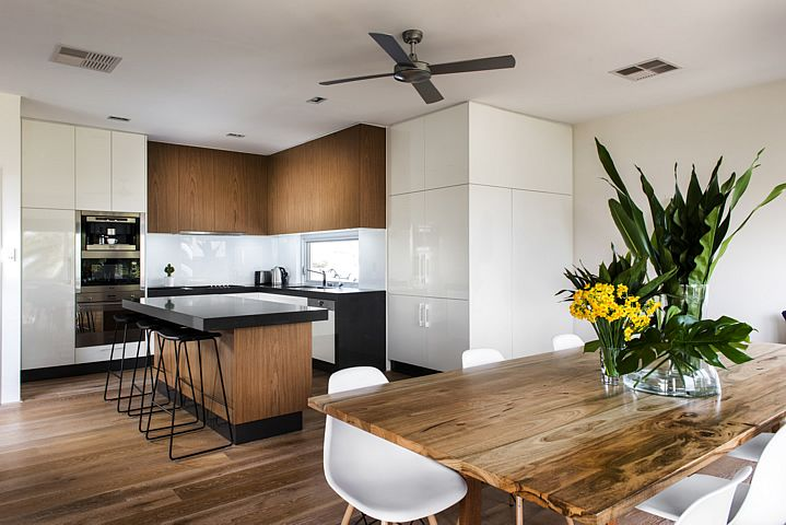 Beach home, wood and white kitchen, by Collected Interiors