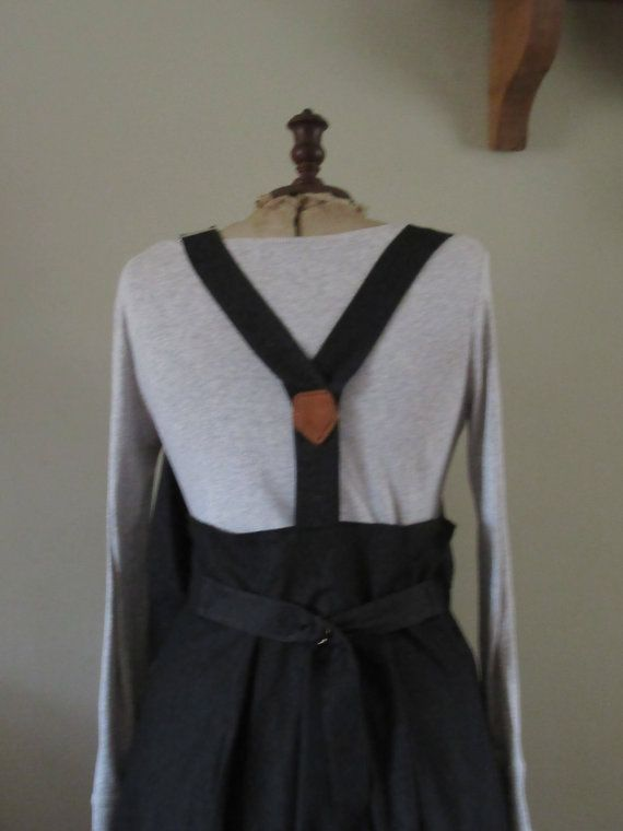 This is a really lovely Lagenlook balloon shaped pinafore dress in Black Denim,always easy to wear..Skirt is balloon shaped and hitched up in 2 places with real leather tabs and buttons,both can be undone if needed,,large really nice shaped pocket to the side which is really handy.The top of skirt has lovely pleats onto the bodice which is fully lined,zip to side.Really quirky braces over shoulders and end on real leather brace ends and 4 buttons.The back braces join in nice V with leather…