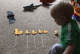 """{10 Little Ducky Puppets} """"All I did was draw 5 smaller ducks and 1 big duck on yellow felt and cut them out. Then I duct taped them to wooden sticks."""" Great book props!"""