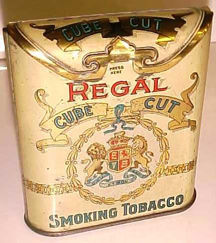 """REGAL CUBE CUT SMOKING TOBACCO POCKET TIN. Measures 4"""" in height X 3 1/2"""" in width X 1 1/8"""" in depth. Manufactured by the Imperial Tobacco Co. of Canada Limited."""