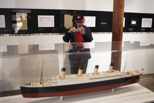 A patron photographs a model at an exhibit at the South Street Seaport Museum commemorating the 100th anniversary of the sinking of the Titanic in New York April 11, 2012.