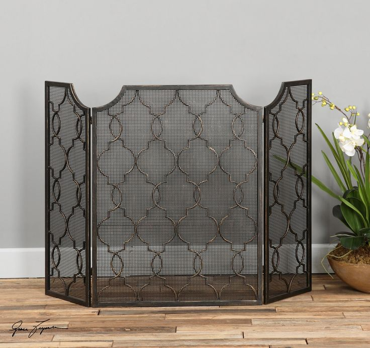 Fireplace Screen with Antiqued Silver Champagne Finish from www.wellappointedhouse.com