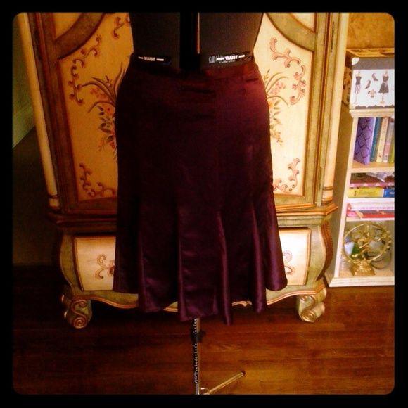 Calvin Klein 100% silk skirt burgundy This is a beautiful  never worn Calvin Klein deep burgundy 100% silk skirt with the trumpet bottom that flows when you walk. Calvin Klein Skirts