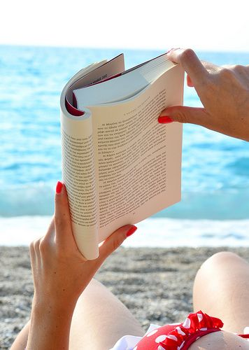 reading a hole book in the beach ..