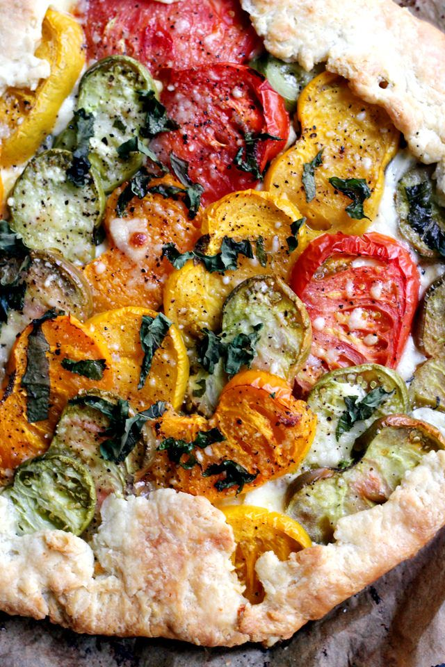 There's no better way to celebrate fresh summer heirloom tomatoes than with this caramelized heirloom tomato and corn galette!
