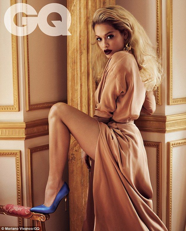 The thigh's the limit! The 22-year-old singer flashed her toned and tanned pins in a daring peach thigh-split gown as she hooked a blue stiletto heel onto the side of an armchair in another stunning shot