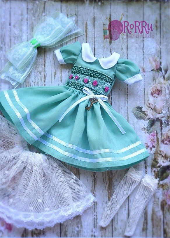 A personal favorite from my Etsy shop https://www.etsy.com/listing/496842290/green-smocked-pastel-dress