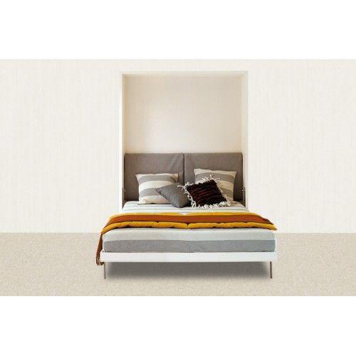 Если спальная комната маленьких размеров и габаритная мебель в ней совершенно излишня, то вполне подходящим вариантом будет откидная кровать. Стандартное спальное место почти не занимает пространства днём.  Вертикальная модель Solo благодаря ортопедическому матрасу комфортна для сна и имеет, как видите, интересный внешний вид. Благодаря специальному механизму кровать очень легко поднимается и опускается.