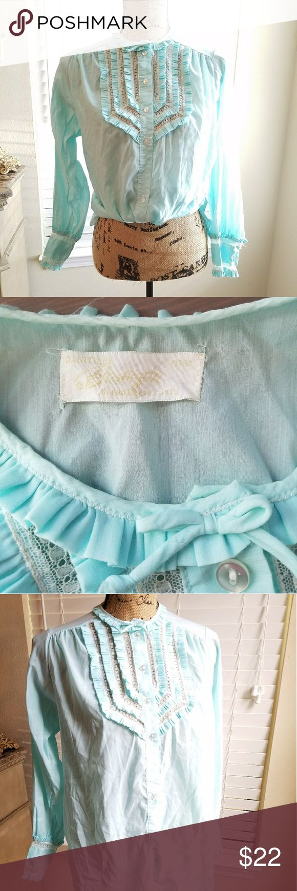 🍍VTG ice blue ruffled long sleeved prairie blouse Vintage ice blue long sleeved button up blouse with white lace ruffled detail with bow on collar. I think this was originally a pj top but I have worn it tucked into hugh waisted trousers to work and it is so cute! It is in excellent vintage condition! Tops Button Down Shirts