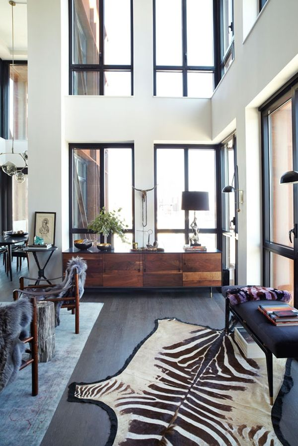 the mix of modern furniture + traditional rug + zebra hide. So chic!