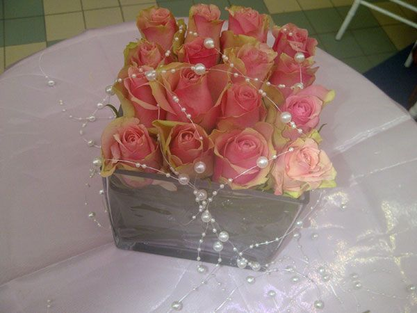 Pink roses with strands of pearls and beads www.iceevents.co.za