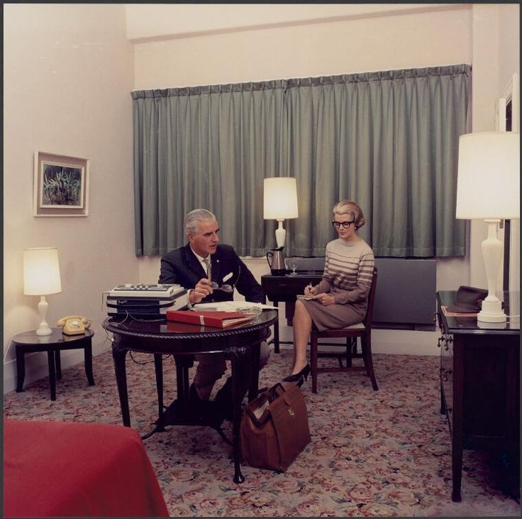 Sievers, Wolfgang, 1913-2007. Businessman dictating to a stenographer in a room at the Menzies Hotel, Melbourne, Australia, 1965 [picture]