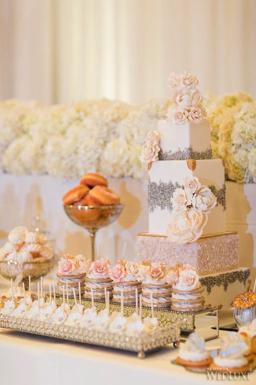Stunning cake and sweet table with donuts, cupcakes, macarons, and more!   Photography By: Ikonica