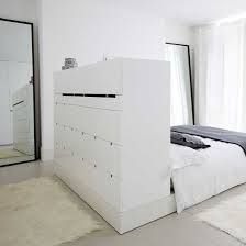 love the storage behind the bed
