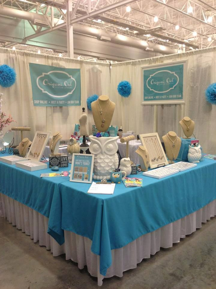 Bold turquoise used in signage, tablecloth and props grabs the eye and sets their craft show booth apart from the rest