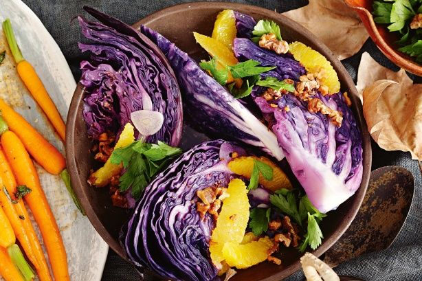 This quick and easy winter salad contrasts the slightly bitter crunch of cabbage and walnuts against the sweetness of the oranges.