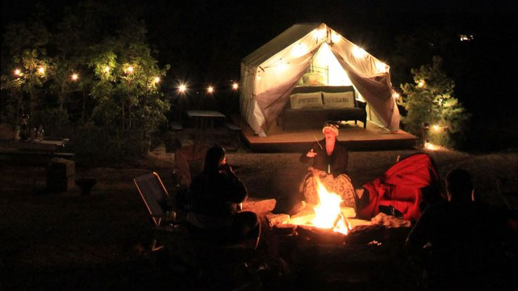 Glamping = camping with creature comforts! Zion Ponderosa Ranch Resort glamping tents feature wooden decks, queen bed, furnishings in campground area | Zion National Park camping