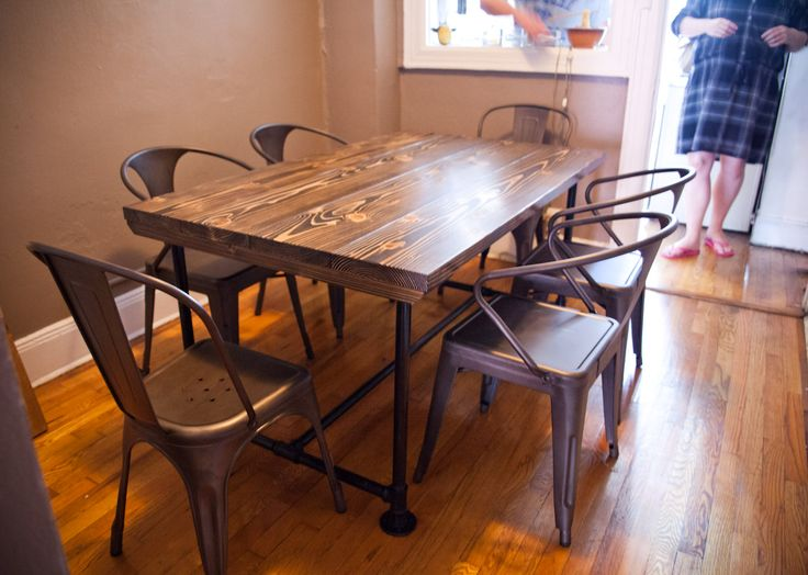 Industrial Style Table With Black Industrial Legs. The Table Top Is Stained  Dark Walnut With