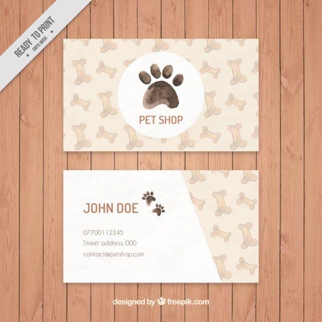 Elegante tarjeta de tienda de mascotas de acuarela con huesos y huella Vector Gratis