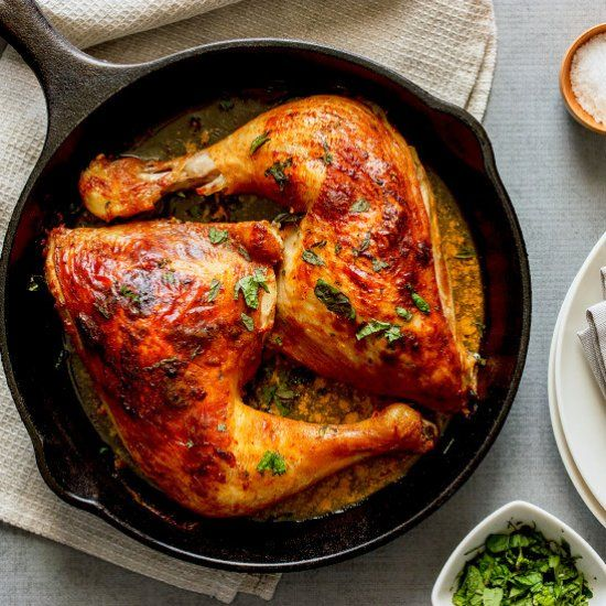 A simple harissa, yoghurt and lemon marinade gives roast chicken pieces wonderful, warming depth, brightened up with fresh mint.