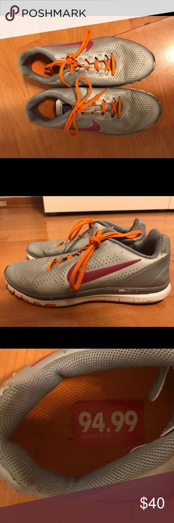 Nike Free runs 3.0 Used Nike Free Runs 3.0 color gray with fuschia check mark, orange laces. Women's 6.5 Nike Shoes Sneakers
