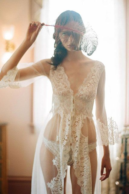 Claire Pettibone's bespoke lace-edge robe is pretty much as elegant as it gets. Its illusion silhouette will ensure you look seriously feminine (in a totally sexy way) all honeymoon long. But wait, ready for the kicker? This beauty is actually embellished with Swarovski crystals. It's the perfect bridal splurge. #refinery29 http://www.refinery29.com/bridal-lingerie#slide-1