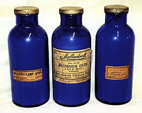 Old medicine bottles with contents still in them.