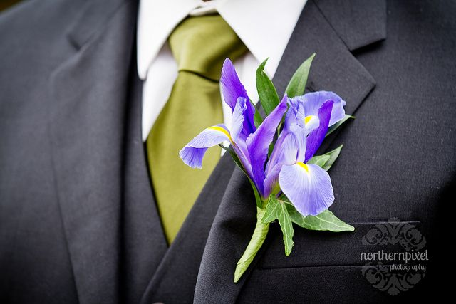 Groom's boutonniere:big iris with limonium and burlap leaf Groomsmen- small iris with some babys breath with twine detail