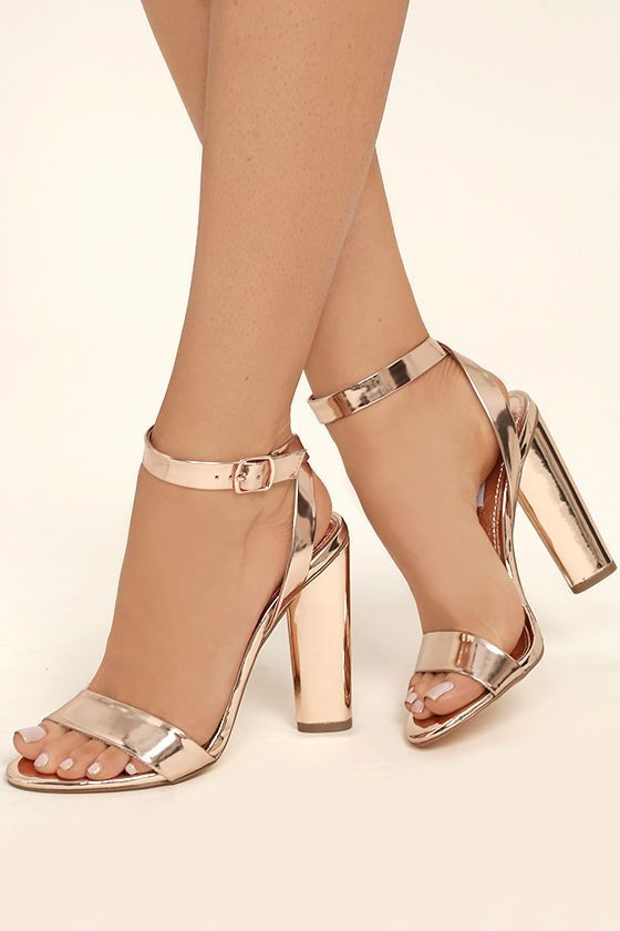 We'll always cherish the Steve Madden Treasure Rose Gold Leather Ankle Strap Heels! Metallic rose gold leather is formed to a classic single sole silhouette with peep-toe upper, and crisscrossing ankle strap with matching buckle.
